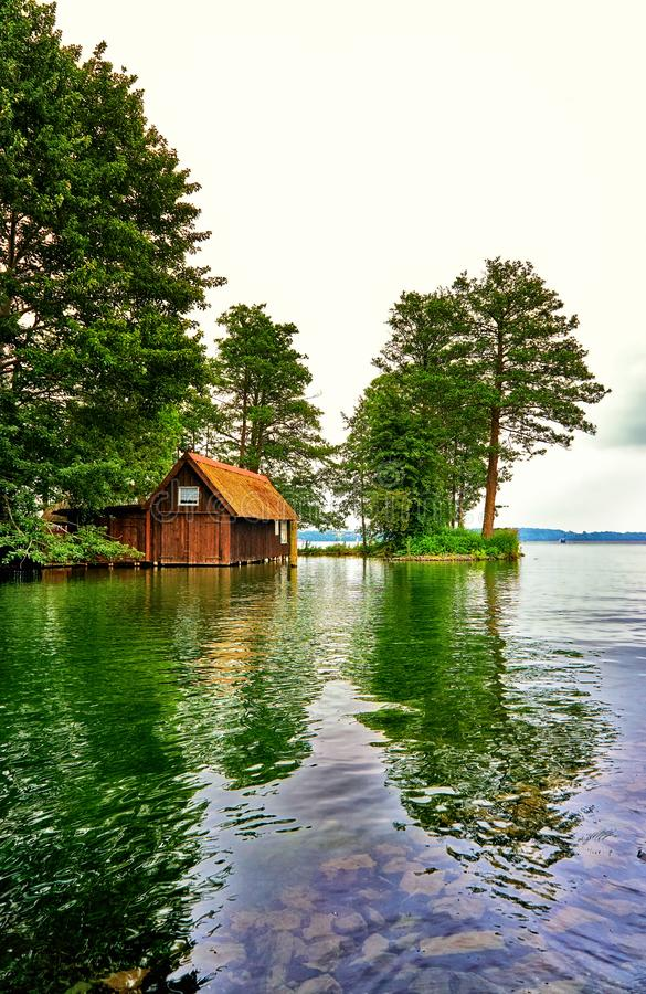 Old wooden boat house with a view of the Schwerin lake. Mecklenburg-Western Pomerania, Germany stock photo