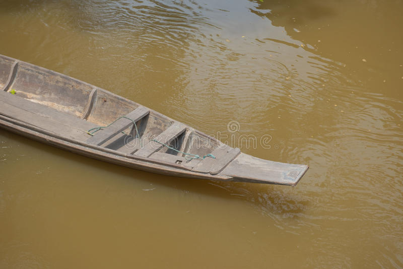 Old wooden boat on a river for background royalty free stock images
