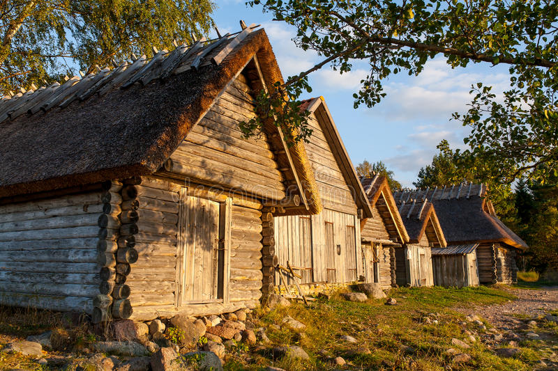 Old wooden boathouse at sunset light in nature. Natural environment background. stock photos