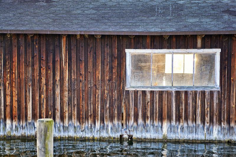 Old wooden boathouse with window royalty free stock images