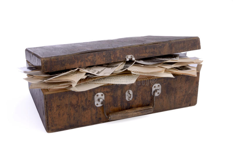 Old wooden box with photos and documents. Old nearly closed wooden box containing old photos, papers and documents, on white background stock images