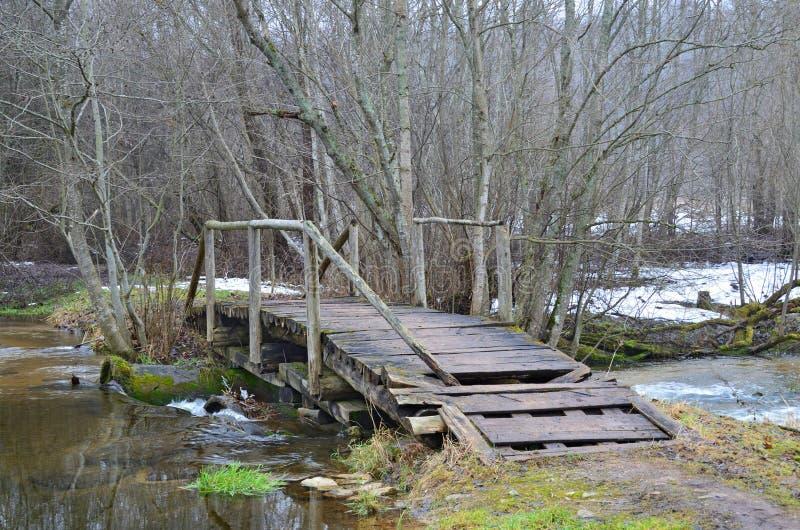 Old wooden bridge across the river Abdeh near the village of Gnilkino. Pskov region, Russia royalty free stock photo
