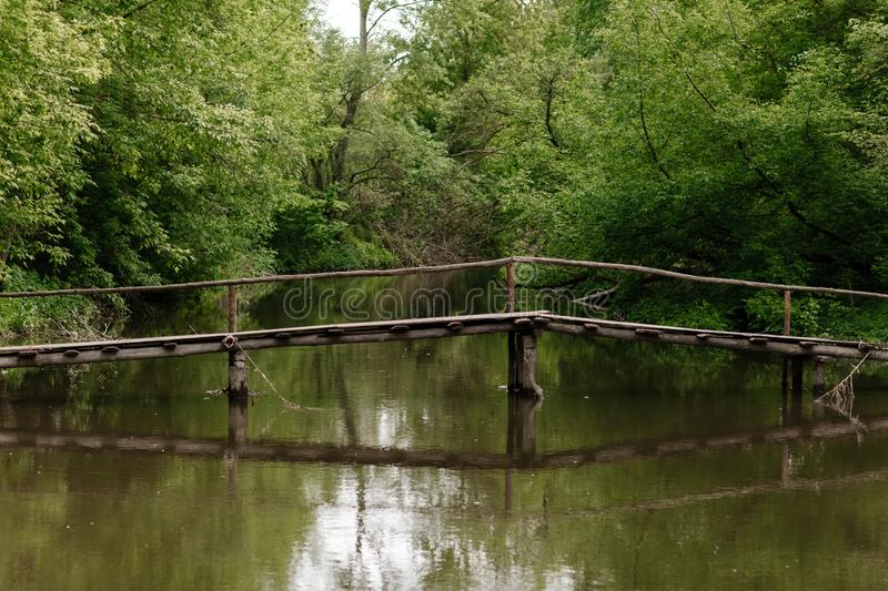 Old wooden bridge, wooden bridge across a small river, bridge with nature.  stock image