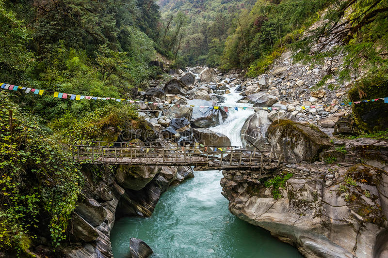 Old wooden bridge on the mountain river. Myagdi in Dhaulagiri region, Nepal royalty free stock photography