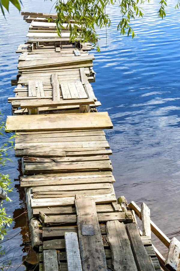 Old wooden bridge on the river. Countryside.  royalty free stock photography