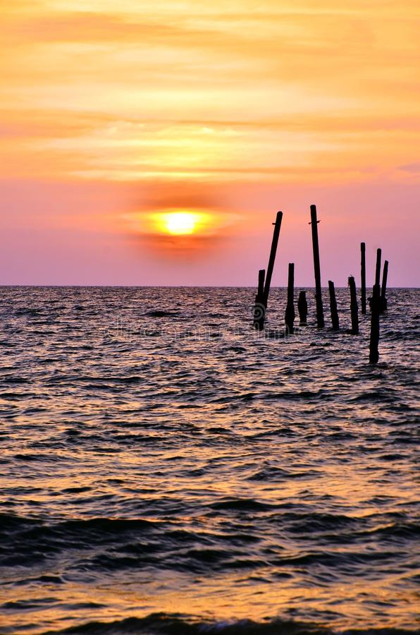 The old wooden bridge and sea wave on the beach at sunset sky background at Khao Pilai, Phangnga, Thailand. Nature landscape royalty free stock photos