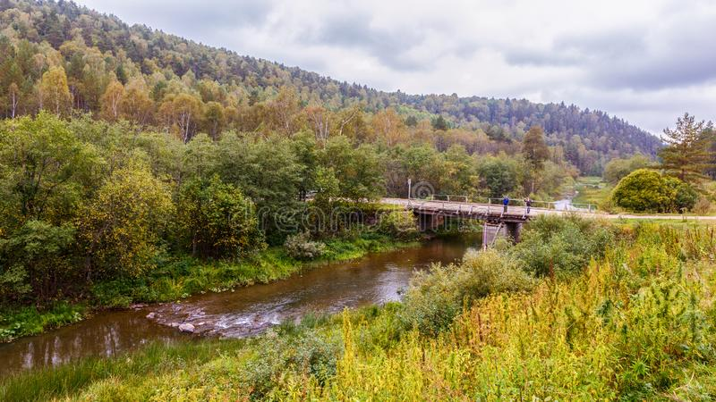 Old wooden bridge in the southern Urals. Old wooden bridge over the river Big Nugush. Taiga of the Southern Urals royalty free stock photos
