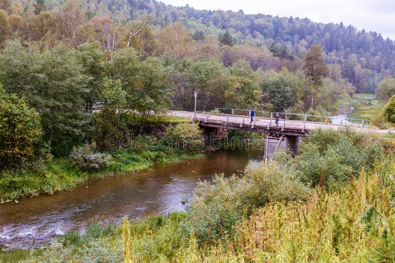 Old wooden bridge in the southern Urals. Old wooden bridge over the river Big Nugush. Taiga of the Southern Urals stock image