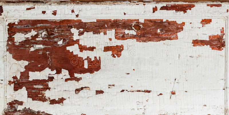 Old wooden brown textured background with peeling paint white color. Place for your text. Old wooden brown textured background with peeling paint white brown royalty free stock image