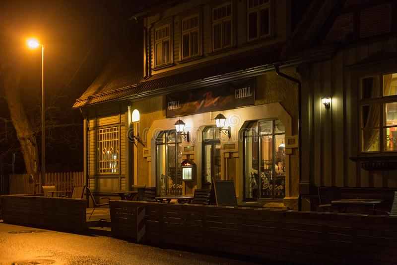 PARNU, ESTONIA - MAY 02, 2015: Old wooden building of La Boca restaurant in historical center of Parnu at night. Old wooden building of La Boca restaurant in stock photos