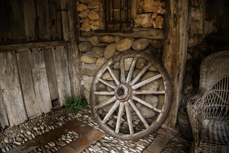 Old wooden carriage wheel royalty free stock photos