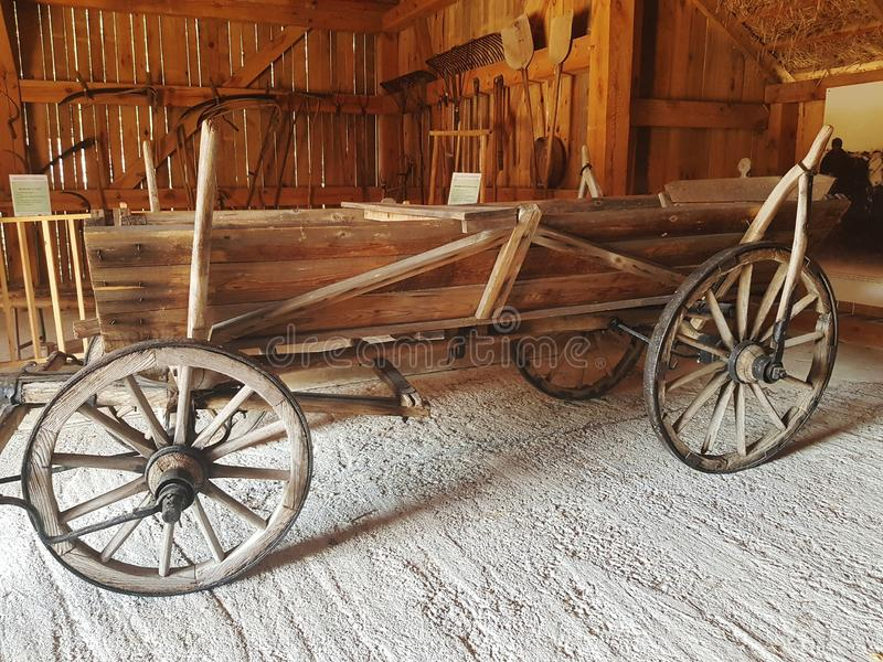 Old wooden Cart in barn stock photography
