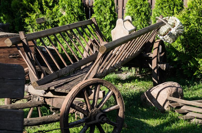 Old wooden cart and wicker basket. Old things from the barn stock image