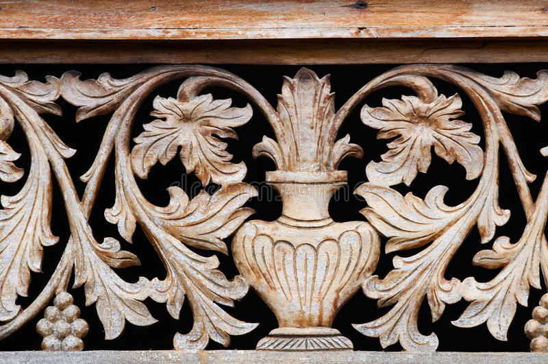 Download Old Wooden Carving With Bowl And Flowers Stock Photo - Image: 25908652