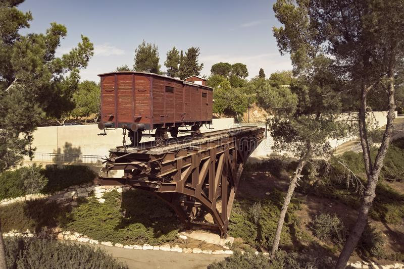 An old wooden cattle rail car that was used to transport Jews to concentration camps during the Holocaust. stock photography