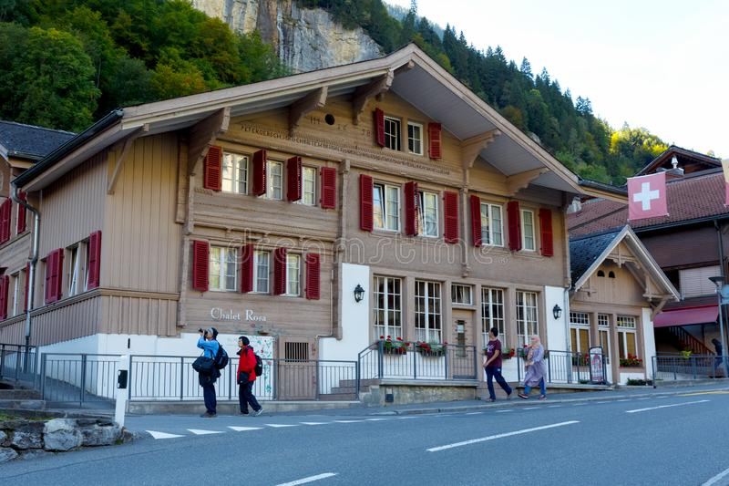 Old wooden chalet in Lauterbrunnen. Lauterbrunnen, Switzerland - 21 September 2017: Old wooden home, which dates back to the mid-seventeenth century, is seen stock photos