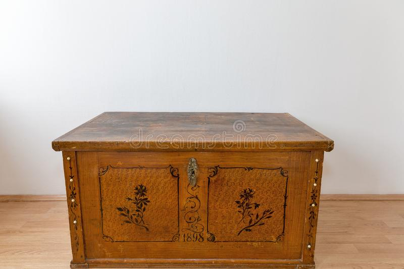 Old wooden chest with closed lit stock image