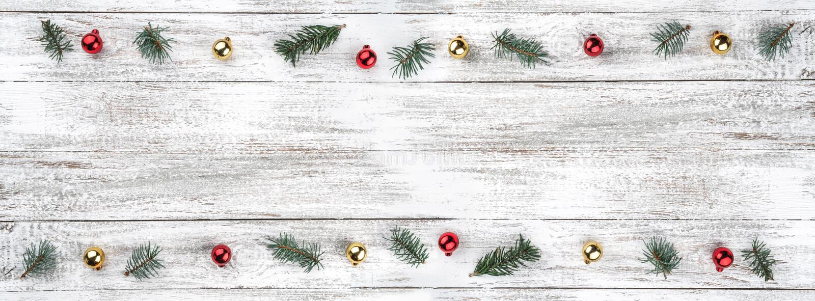Old wooden Christmas background. Fir branches. Gold and red baubles. Christmas card. Top view. Space for your text. Horizontally card royalty free stock image