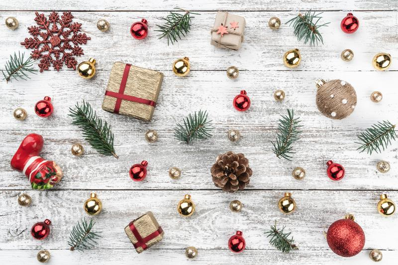 Old wooden Christmas background. Red and gold Baubles. Fir branches and cones. Top view. Horizontally Xmas card.  stock photos
