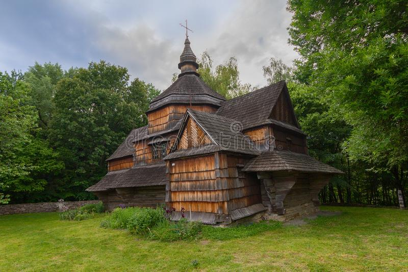 Old wooden church among dense foliage in the open-air museum Pirogovo stock photos