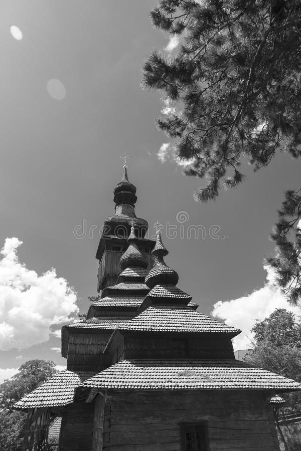 The old wooden church Lemka. Black and white sky with clouds. royalty free stock image