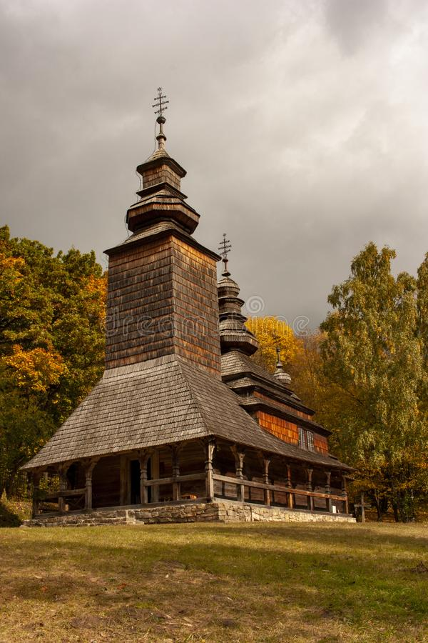 Old wooden church in the museum Pirogovo in the fall season. Kiev, Ukraine stock photo