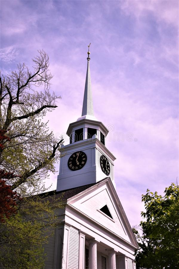 Old wooden church and steeple, located in Town of Groton, Middlesex County, Massachusetts, United States. New England. Church and meetinghouse located in town of stock photos