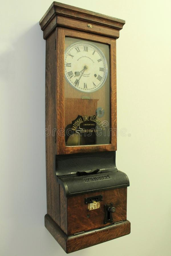 Old wooden clock. Old and beautiful vintage wooden clock royalty free stock image