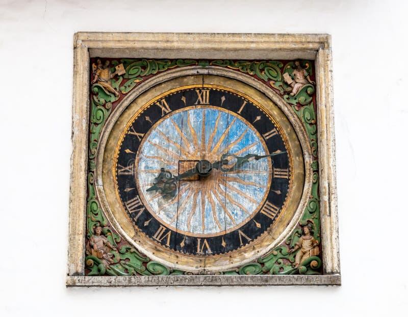 Old wooden clock in Tallinn, Estonia royalty free stock image