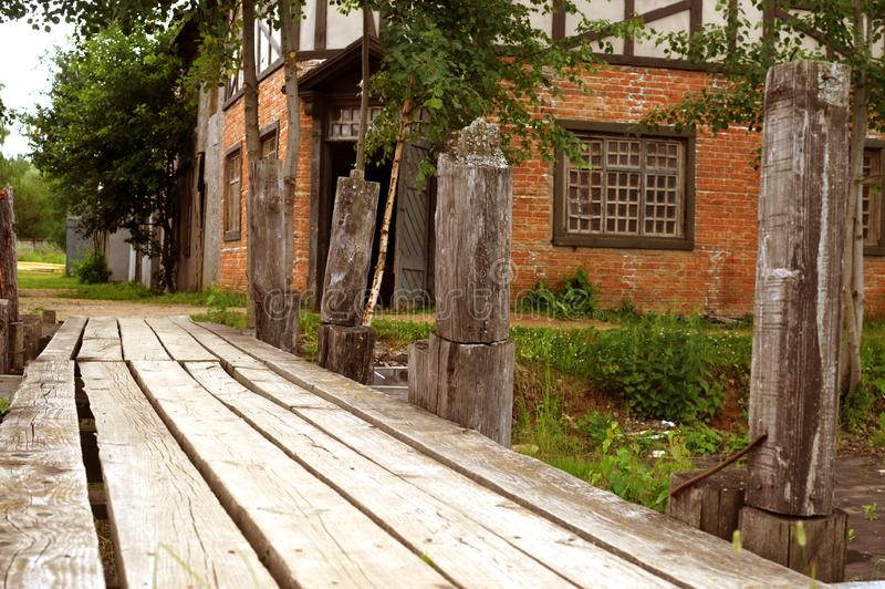 The old wooden collapsed bridge stock photography