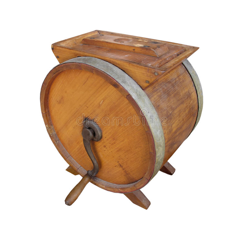 Old wooden crank butter churn isolated. Old round wooden hand crank butter churn. Isolated on white royalty free stock images