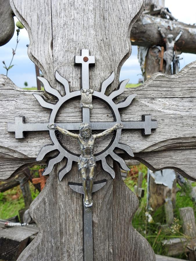 Old wooden cross on hill, Lithuania stock images