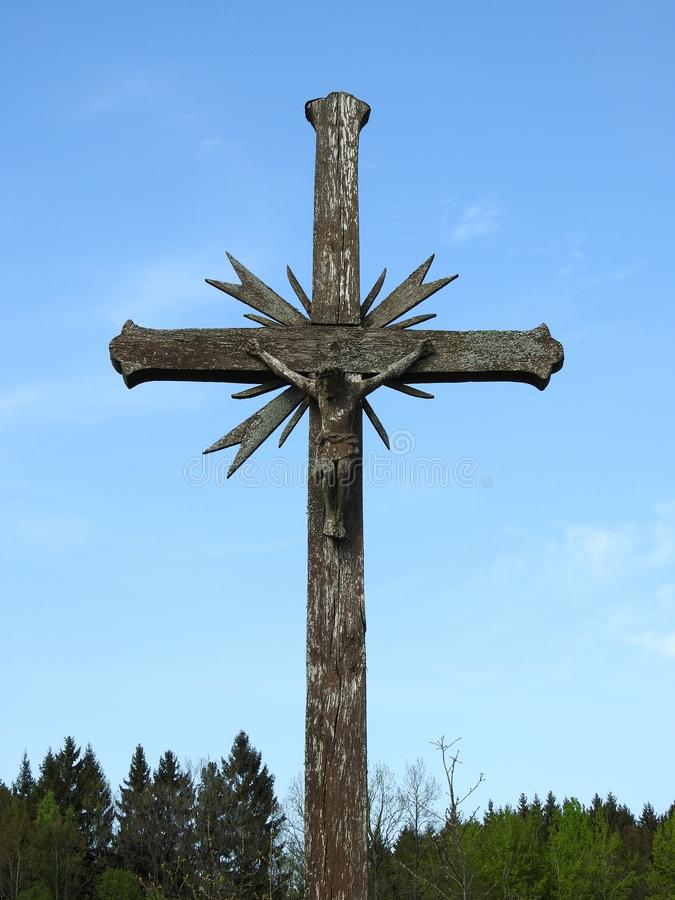 Old wooden cross and Jesus Christ, Lithuania stock images