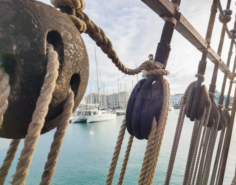 Old wooden deadeye on the shrouds of a sailing vessel of the eighteenth century royalty free stock image