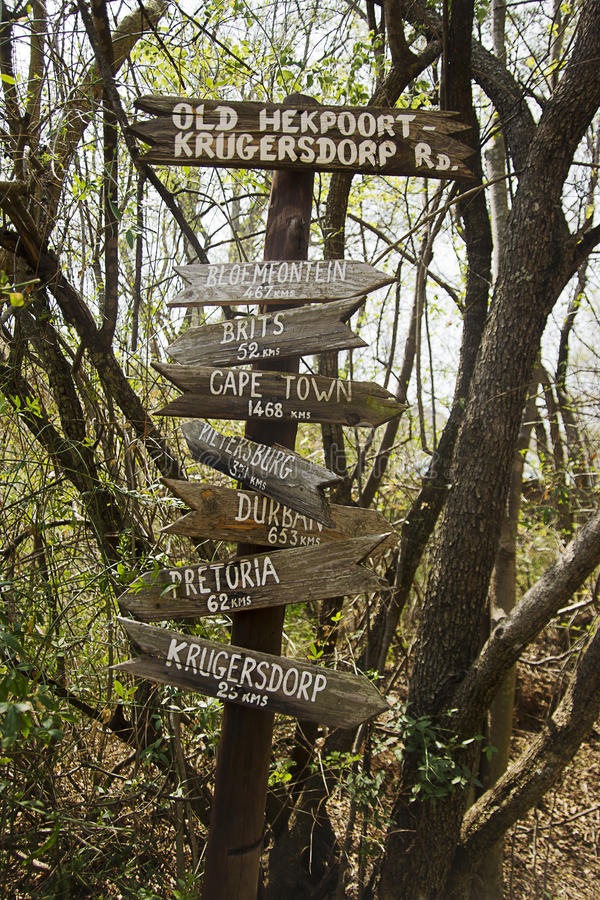 Old Wooden Directional Sign. Multiple destination directional sign, posted in the middle of the woods royalty free stock photography