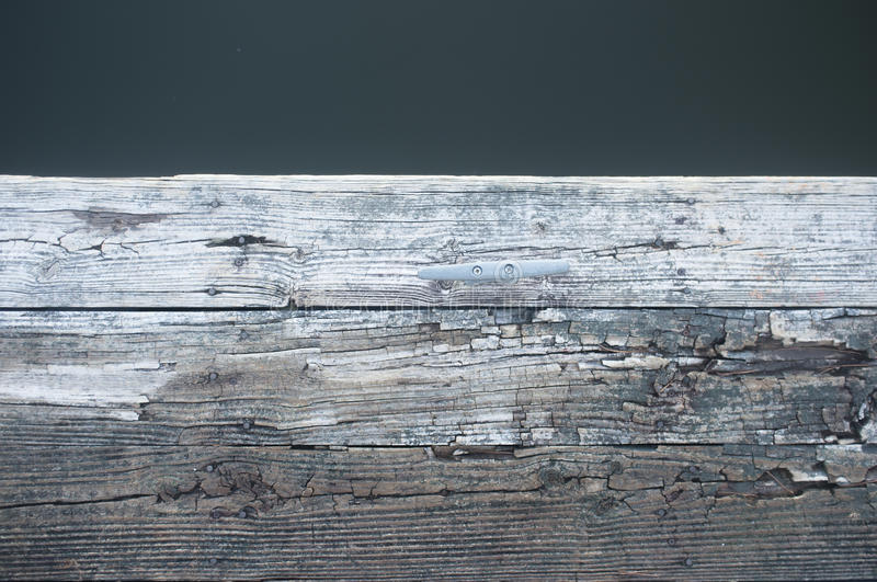 Old wooden dock on the lake royalty free stock photo