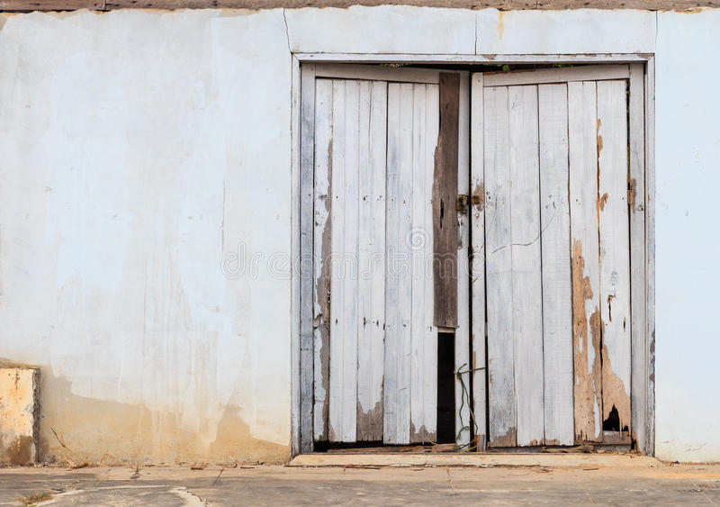 Old wooden door in the city of Si Sa Ket, Thailand. The old wooden door in the city of Si Sa Ket, Thailand royalty free stock image