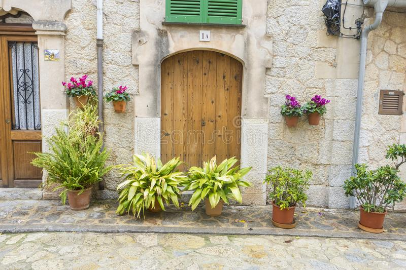 old wooden door in a coastal village of the island of Mallorca i royalty free stock photo