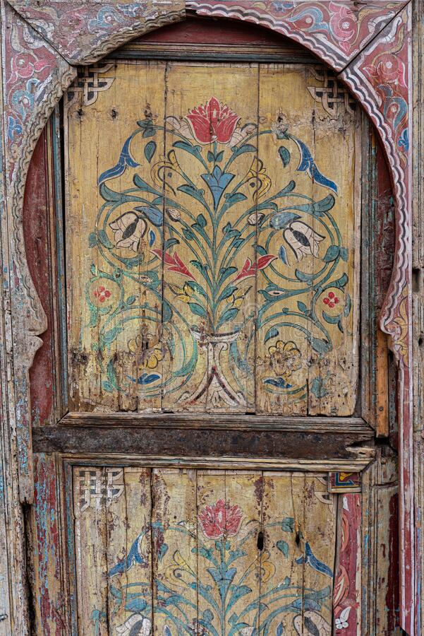 Old wooden door decorated with flower drawing ornaments, Marrakesh, Morocco. Old wooden door decorated with flower drawing ornaments, Marrakesh royalty free stock photography