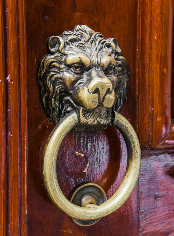 Old wooden door decorated with a lion head royalty free stock images