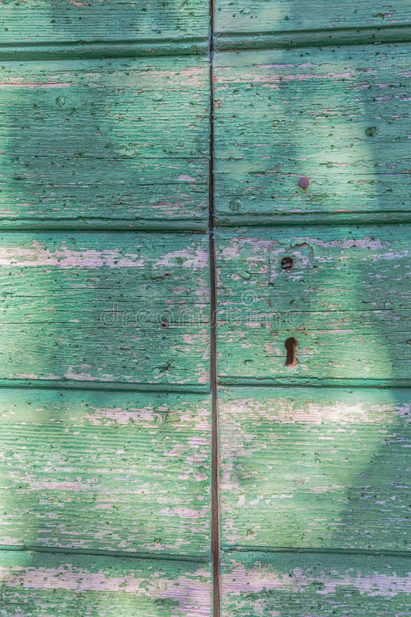Old wooden door. Detail of old wooden door of the typical house in Tucepi village, Croatia royalty free stock image