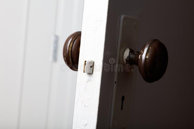 Old wooden door with door knob. Close up stock image