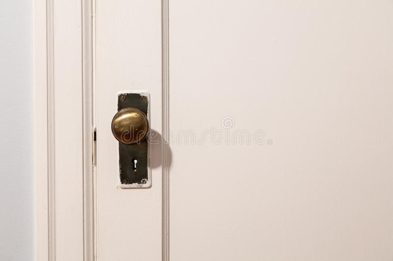 Old wooden door with door knob. Close up royalty free stock photography