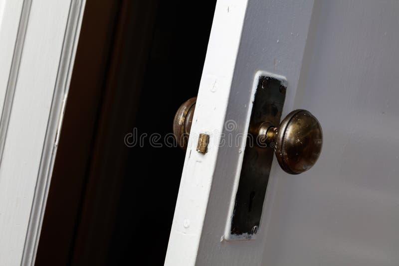 Old wooden door with door knob. Close up stock photography