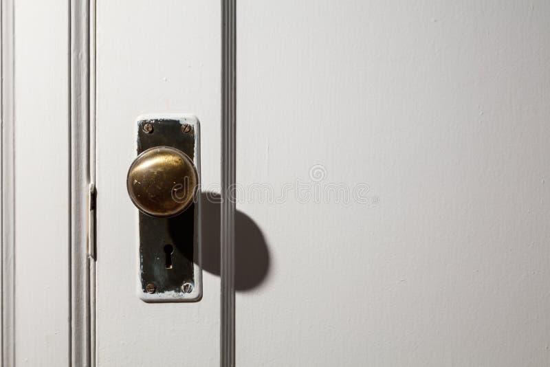 Old wooden door with door knob. Close up royalty free stock photos
