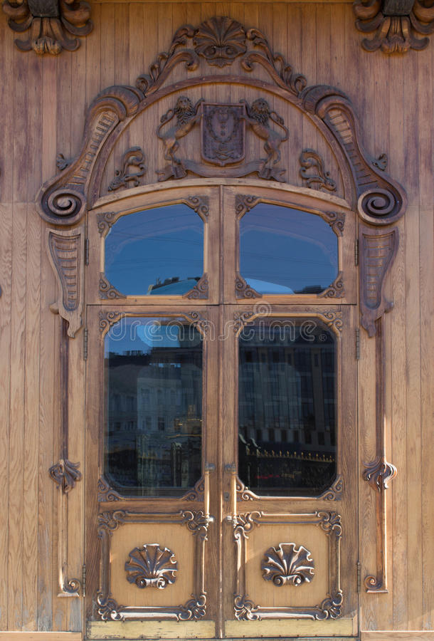 Old wooden door with glass.woodcarving stock image