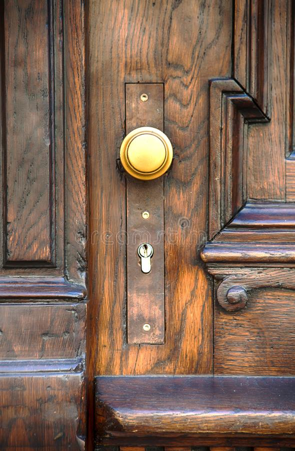 Old wooden door with golden doorknob royalty free stock photo