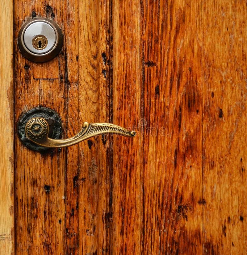 Old wooden door with hande and lock close up royalty free stock photos