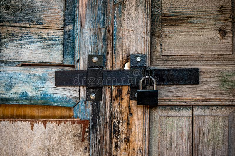 Old wooden door with a heavy lock stock photos