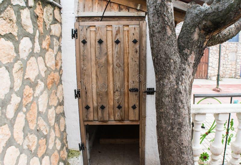 Old wooden door in home garden stock images